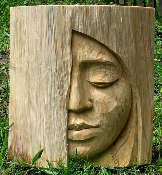 Anahata katkin call me crazy chainsaw carving
