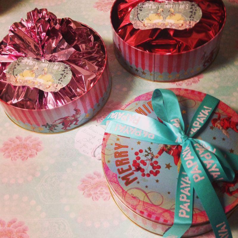 Holiday papaya cookie tins